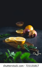 Oranges on a dark moody background, vintage retro style, fresh fruits with green leaves vertical view