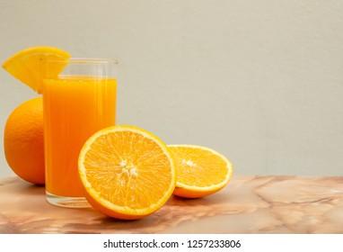 oranges and orange juice on white background,