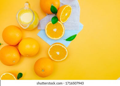 Oranges with orange juice on yellow background