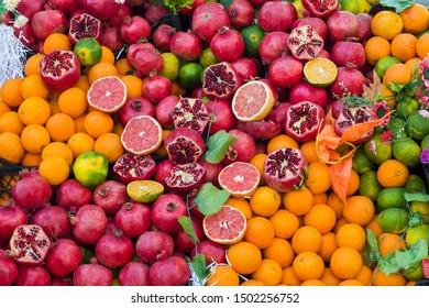 Oranges pomegranate grapefruit lime in the street market. Juicy fresh fruit for fresh juice