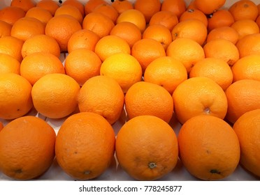 Oranges are sold in fruit shops.