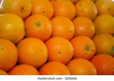 Oranges stacked on each other in daylight