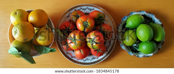 oranges-tomatoes-lemon-limes-plates-600w