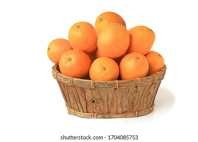 Oranges in a wooden basket isolated on white background