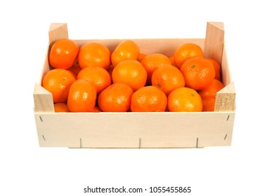 Oranges in wooden box, isolated on white background