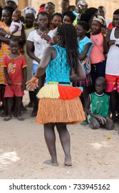 ORANGO ISL., GUINEA BISSAU - MAY 3, 2017: Unidentified local woman in a straw skirt dances  during Vaca Bruto, traditional Mask dance