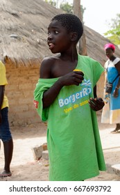 ORANGO ISLAND, GUINEA BISSAU - MAY 3, 2017: Unidentified local little boy in green shirt looks away in the Etigoca village. People in G.-Bissau suffer of poverty due to the bad economy