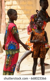 ORANGO ISLAND, GUINEA BISSAU - MAY 3, 2017: Unidentified local children talk about something in the Etigoca village. People in G.-Bissau suffer of poverty due to the bad economy