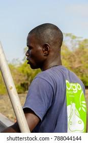 ORANGO ISLAND, GUINEA BISSAU - MAY 3, 2017: Unidentified local man stands in a boat on the Orango Island, Guinea Bissau