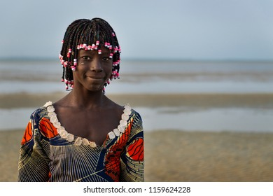 Orango Island, Guinea-Bissau - February 2, 2018:  Portrait of a beautiful young girlr in the beach in the island of Orango at sunset.