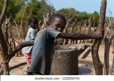 Orango Island, Guinea-Bissau - February 3, 2018:  Group of boys drewing water from a comminity well at village of Eticoga in the island of Orango.