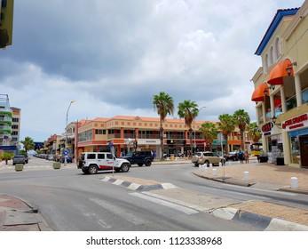 Oranjestad, Aruba; 04 25 2018: Beautiful panoramic view of the coastline city of Oranjestad with stores and people shopping