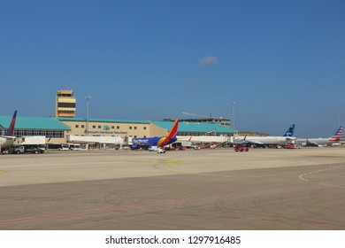 ORANJESTAD, ARUBA -12 JAN 2019- View of airplanes at the Queen Beatrix International Airport (AUA) in Aruba in the Caribbean.