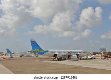 ORANJESTAD, ARUBA -12 JAN 2019- View of an airplane from Aruba Airlines (AG) at the Queen Beatrix International Airport (AUA) in Aruba in the Caribbean.