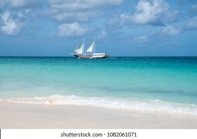 Oranjestad, Aruba - April 10, 2018: A Schooner Carrying People Sailing on the Caribbean Sea near Eagle Beach