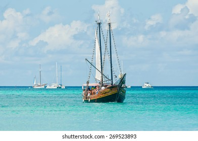 ORANJESTAD, ARUBA - DECEMBER 01: Tourists sailing aboard Jolly Pirates along the coastline and enjoy the beautiful tropical island of Aruba at December 01, 2011.