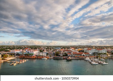 Oranjestad, Aruba - December 1, 2011: View of Oranjestad, capital of Aruba. Small boats and yachts are moored to the jetty and white Dutch style buildings are in the middle.
