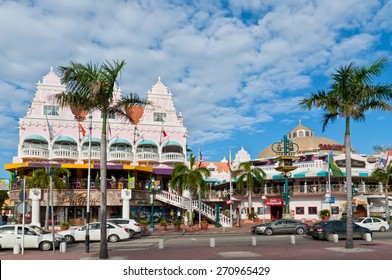 ORANJESTAD, ARUBA - DECEMBER 1: On Main Street, Oranjestad, stands a colorful mall containing shops and restaurants at December 1, 2011. Tourists can be seen entering the mall.