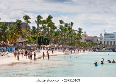 ORANJESTAD, ARUBA - DECEMBER 1: People on the beach and in the water on the well known Palm Beach in Aruba at December 1, 2011.