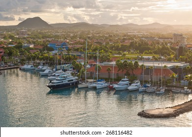 ORANJESTAD, ARUBA - DECEMBER 1: A view of the harbor on Aruba looking inland in the gentle rays of the morning sun at December 1, 2011. Photo from a cruise ship, looks down over the city and yachts.