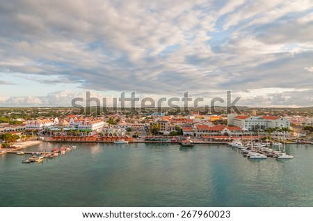 ORANJESTAD, ARUBA - December 1: A view of Oranjestad, capital of Aruba. Small boats and yachts are moored to the jetty and white Dutch style buildings are in the middle at December 1, 2011.