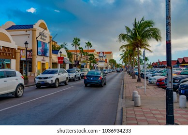 Oranjestad, Aruba - January 10 2018: view of the city of Oranjestad in the Caribbean island of Aruba with the colored buildings and the tourist port of the cruise ships