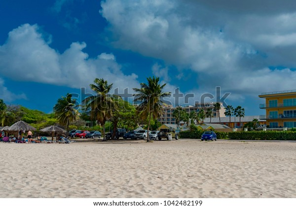 Oranjestad, Aruba - January 10 2018:   tropical beach panorama of the Caribbean sea with luxury hotel in the background in the Aruba island of the Netherlands Antilles