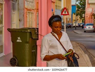 Oranjestad, Aruba - January 11 2018:   daily life of people walking down the street in the streets of the vibrant city of Oranjestad of Aruba Caribbean Island