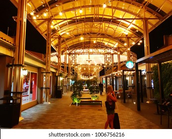 Oranjestad, Aruba - January 12 2018: A tourist walks in the shopping mall of the Renaissance Hotel in Oranjestad.