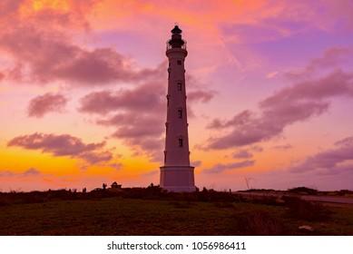 Oranjestad, Aruba - January 12 2018: California Lighthouse, at colored sunset in Aruba island in the sea of the caribbean