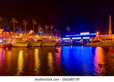 Oranjestad, Aruba - January 14 2018: streets of the colorful city of Oranjestad island of Aruba in the Dutch style Caribbean sea at night with lights on