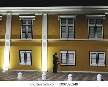 Oranjestad, Aruba - January  15, 2018: Person walk in the main street of Oranjestad at night.
