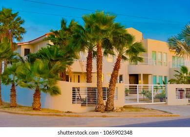 Oranjestad, Aruba - January 15 2018: colorful and bright sunset on the coast of the Caribbean sea on the island of Aruba...