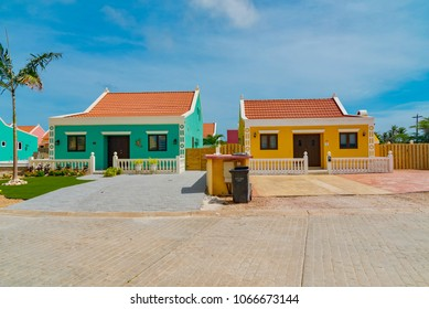 Oranjestad, Aruba - January 15 2018: colorful Caribbean-style residential neighborhood with palm trees and cactus in the gardens on the Caribbean island in Aruba Netherlands Antilles