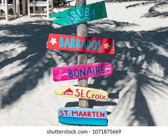 Oranjestad, Aruba - January 15 2018:  colorful wooden sign on tropical beach indicating the Caribbean islands on the island of Aruba in the Netherlands Antilles
