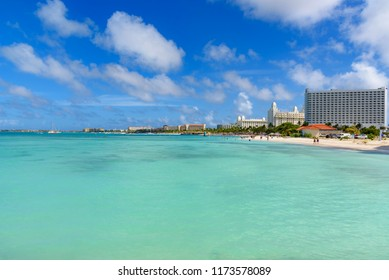 Oranjestad, Aruba - January 15, 2018: View of the paradisiac Eagle Beach in Aruba with tourists and a row of resorts.