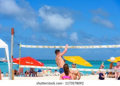 Oranjestad, Aruba - January 15, 2018: People play beach volleyball in the beautiful Eagle Beach in Aruba