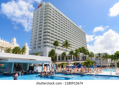 Oranjestad, Aruba - January 15, 2018: View of a giant resort in Aruba with tourists relax and have fun in a swimming pool.
