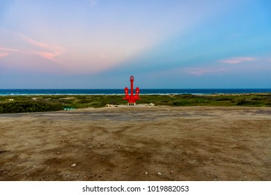 Oranjestad, Aruba - January 5, 2018: A sculpture in the shape of red anchor along the way to the Natural Bridge in Aruba.