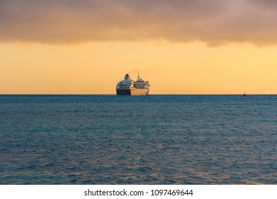 Oranjestad, Aruba - January 9, 2018: View of a boat at sunset in the Caribbean Sea near Oranjestad.