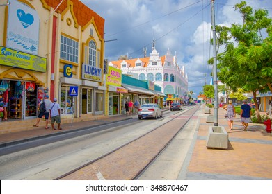 ORANJESTAD, ARUBA - NOVEMBER 05, 2015: Streets of Aruba Island, downtown shopping district with tram tracks