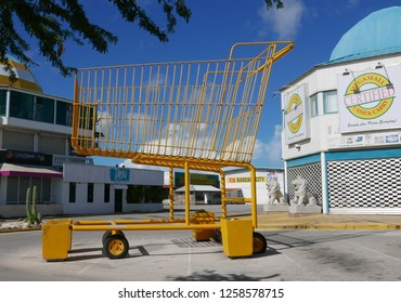 Oranjestad, Aruba, November 11: oversized yellow shopping cart in front of a supermarket