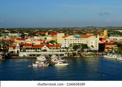 Oranjestad, Aruba - November 17, 2018 - The view of the harbor, boats and buildings along the ports