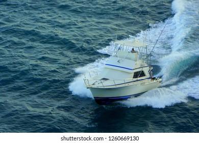 Oranjestad, Aruba - November 17, 2018 - Fishing boat speeding on the bay