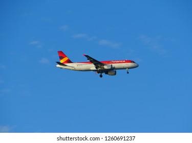 Oranjestad, Aruba - November 17, 2018 - Avianca Airlines plane flying on the sky