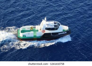 Oranjestad, Aruba - November 17, 2018 - A pilot boat assisting cruiseship on the bay