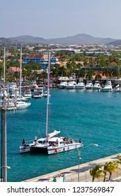 Oranjestad, Aruba-January 11, 2014: Catamaran and other boats in the small harbor of Oranjestad