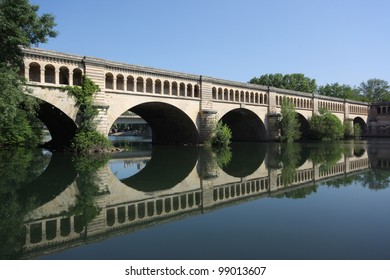 The Orb Aqueduct, a bridge which carries the Canal du Midi over the Orb River in the city of Bezieres in Languedoc-Roussillon, France.