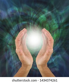 Orb Light Paranormal Phenomenon  - hands cupped around a bright white orb light against a green rotating energy field background with copy space