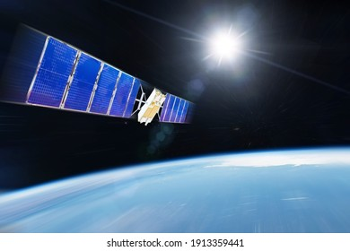 Orbiting communications satellite and other researchers with probes rushes motion blur speed into Earth orbit. Elements of this image furnished by NASA